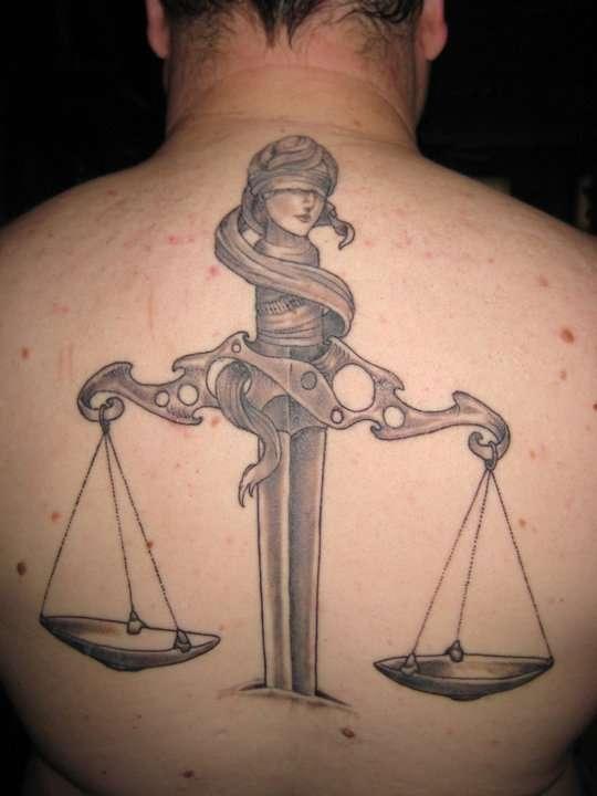 justice tattoos photo - 7